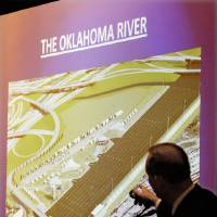 Photo - Mayor Mick Cornett gestures at an architect's rendering of the Oklahoma River while talking about MAPS 3 during a luncheon in downtown Oklahoma City Wednesday, Oct. 21, 2009. Photo by Paul B. Southerland, The Oklahoman ORG XMIT: KOD
