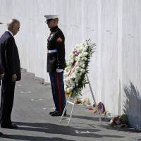 Photo -   Vice President Joe Biden, third from left, Interior Secretary Ken Salazar, second from left, and President of the Families of Flight 93, Patrick G. White, left, pauses after laying a wreath at The Wall of Names at the Flight 93 National Memorial in Shanksville, Pa., Tuesday, Sept. 11, 2012. (AP Photo/Gene J. Puskar)