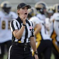 Photo - In this photo provided by the NFL, official Catherine Conti yells for a ball at the International Women's Football League Championships, Saturday, July 26, 2014. in Rock Hill, S.C. The 38-year-old Conti had been assigned to the Southeast Missouri State-Kansas game on Sept. 6, making her the first woman to work a football game in the Big 12 Conference. Conti will work mostly as a line judge in the Mountain West for the second straight year. She landed the Big 12 gig through the league's officiating partnership with the Mountain West and FCS-level Southland Conference. (AP Photo/NFL, Bob Leverone)