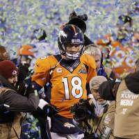 Photo - Denver Broncos quarterback Peyton Manning walks off the field after the Broncos lost to the Seattle Seahawks in the NFL Super Bowl XLVIII football game Sunday, Feb. 2, 2014, in East Rutherford, N.J. The Seahawks won 43-8. (AP Photo/Chris O'Meara)