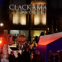 Photo - Police and medics work the scene of a multiple shooting at Clackamas Town Center Mall in Portland, Ore., Tuesday Dec. 11, 2012. A gunman is dead after opening fire in the Portland, Ore., area shopping mall Tuesday, killing two people and wounding another, sheriff's deputies said. (AP Photo/Greg Wahl-Stephens)