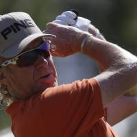 Photo - Miguel Angel Jimenez of Spain plays a shot off the 10th tee during the second round of the British Open Golf Championship at Muirfield, Scotland, Friday July 19, 2013. (AP Photo/Jon Super)