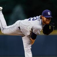 Photo - San Diego Padres starting pitcher Ian Kennedy throws to the plate against the Colorado Rockies during the first inning of an MLB baseball game on Monday, July 7, 2014, in Denver (AP Photo/Jack Dempsey)