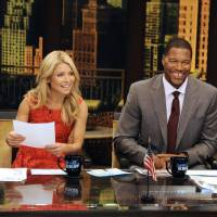 Photo -   This undated photo shows former football player Michael Strahan, right, and host Kelly Ripa during Strahan's guest-host appearance on