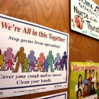 Photo -  Oklahoma City Public  School officials emphasize cleanliness and other ways to combat the spread of swine  flu as the district prepares for the start of the new  school year. Signs on  school nurse's office door remind students to be vigilant in the effort to prevent the spread of germs at Sequoyah Elementary  School on Friday, Aug. 14, 2009. Photo by Jim Beckel