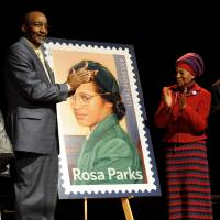 Photo - Councilwoman Joann Watson, from left, Lloyd Wesley, Jr., Detroit postmaster,  Elaine Eason Steele, co-founder of the Rosa and Raymond Parks Institute for Self Development, and Sen. Carl Levin applaud at the unveiling of the Rosa Parksí 100th birthday commemorative postage stamp at the Museum of African American History in Detroit on Monday, Feb. 4, 2013. The Rosa Parks Forever Stamp went on sale Monday and was part of a series of events scheduled throughout the day to honor her. AP Photo/The  Detroit News, David Coates)  DETROIT FREE PRESS OUT, HUFFINGTON POST OUT