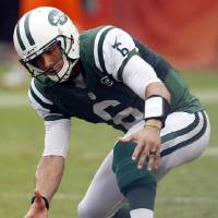 Photo -   New York Jets quarterback Mark Sanchez fumbles the ball and then recovers it during overtime of an NFL football game against the Miami Dolphins, Sunday, Sept. 23, 2012, in Miami. The Jets won 23-20 in overtime. (AP Photo/Wilfredo Lee)