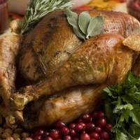 Photo - Thanksgiving can be a difficult time for people on a diet. Portion control is an important component to keep in mind. Experts say you should fill half your plate with fruits and vegetables.  Larry Crowe - AP