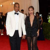 Photo - FILE - This May 5, 2014 file photo shows Jay Z, left, and Beyonce at The Metropolitan Museum of Art's Costume Institute benefit gala celebrating
