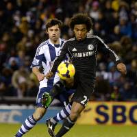Photo - Chelsea's da Silva Willian, right,  and West Bromwich Albion's Claudio Yacob in action during their English  Premier League match at the The Hawthorns Stadium, West Bromwich England Tuesday Feb. 11, 2014.(AP Photo/ Martin Rickett/PA)  UNITED KINGDOM OUT