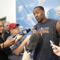 Photo - Oklahoma City Thunder's Kendrick Perkins is interviewed by members of the media after practice in Oklahoma City, March 1 , 2011. Photo by Steve Gooch, The Oklahoman