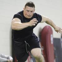 Photo - Collin Mooney, West Point's all-time single-season rushing leader with 1339 yards, works out during the University of Oklahoma pro timing day on Tuesday, March 8, 2011, in Norman, Okla.  He is currently stationed at Fort Sill in Oklahoma. Photo by Steve Sisney, The Oklahoman