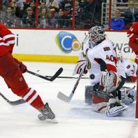 Photo - Carolina Hurricanes' Manny Malhotra (22) shoots the puck past Ottawa Senators goalie Robin Lehner (40) for a goal during the second period of an NHL hockey game in Raleigh, N.C., Saturday, Jan. 25, 2014. (AP Photo/Karl B DeBlaker)
