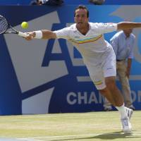 Photo - Radek Stepanek of Czech Republic plays a return to Kevin Anderson of South Africa in their Queen's Club grass court championships quarterfinal tennis match in London, Friday June 13, 2014. (AP Photo/Sang Tan)