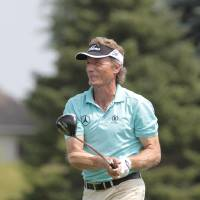 Photo - Bernhard Langer, of Germany, hits his drive off the first tee during the first round of the 3M Championship golf tournament at the TPC Twin Cities in Blaine, Minn. Friday, Aug 1, 2014. AP Photo/Paul Battaglia)
