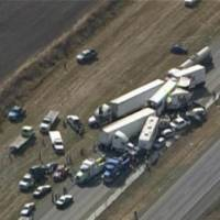 Photo -   In this image provided by Click2houston.com cars and trucks are piled on Interstate 10 in Southeast Texas Thursday Nov. 22, 2012. The Texas Department of Public Safety says at least 35 people have been injured in a more than 50-vehicle pileup. (AP Photo/Click2houston.com) MANDATORY CREDIT