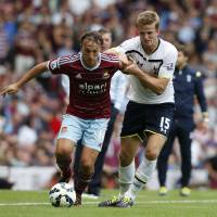 Photo - West Ham United's Mark Noble, left, competes for the ball with Tottenham Hotspur's Eric Dier during their English Premier League soccer match at Upton Park, London, Saturday, Aug. 16, 2014. (AP Photo/Sang Tan)