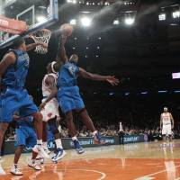 Photo -   Dallas Mavericks' Elton Brand (42) blocks a shot by New York Knicks' Ronnie Brewer during the first half of an NBA basketball game Friday, Nov. 9, 2012, in New York. (AP Photo/Frank Franklin II)