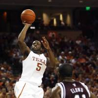 Photo - University of Texas' Damion James shoots as Texas A&M's Chinemelu Elonu looks on during their NCAA college basketball game in Austin, Texas, on Saturday, Jan. 24, 2009. Texas won 67-58. James scored 28 points. (AP Photo/Deborah Cannon) ORG XMIT: TXDC108
