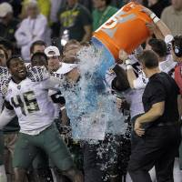 Photo - Oregon head coach Chip Kelly gets soaked by his players during the final seconds of the second half of the Fiesta Bowl NCAA college football game, Thursday, Jan. 3, 2013, in Glendale, Ariz. Oregon won 35-17.(AP Photo/Matt York)