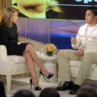 Photo - In this photo taken on Jan. 22, 2013 and released by ABC Notre Dame linebacker Manti Te'o, right, speaking with host Katie Couric during an interview for