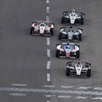 Photo - Will Power (12) takes the green flag in front of Josef Newgarden (67), Tony Kanaan (10), Juan Pablo Montoya (2) and Ed Carpenter (20) at the start of an IndyCar auto race at Texas Motor Speedway in Fort Worth, Texas, Saturday, June 7, 2014. (AP Photo/Ralph Lauer)