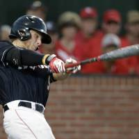 Photo - Louisiana Lafayette's Tyler Girouard (9) hits a three run home run in the third inning of an NCAA college baseball tournament super regional game against Mississippi in Lafayette, La., Saturday, June 7, 2014. (AP Photo/Gerald Herbert)