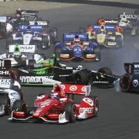Photo - Sebastien Bourdais, (11), loses control and collides with Ryan Briscoe, (8), during the GoPro Grand Prix of Sonoma IndyCar series auto race, Sunday, Aug. 24, 2014, in Sonoma, Calif. (AP Photo/Elijah Nouvelage)