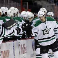 Photo - Dallas Stars center Tyler Seguin, right, celebrates his goal with his teammates in the first period of an NHL hockey game against the Washington Capitals, Tuesday, April 1, 2014, in Washington. (AP Photo/Alex Brandon)