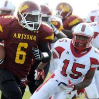 Photo - Oklahoma running back signee Damien Williams, who played at Arizona Western, carries the ball in a 2011 game. PHOTO PROVIDED