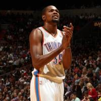 Photo -  MIAMI, FL - JANUARY 29: Kevin Durant #35 of the Oklahoma City Thunder looks on against the Miami Heat at the American Airlines Arena in Miami, Florida on Jan. 29, 2014. NOTE TO USER: User expressly acknowledges and agrees that, by downloading and/or using this photograph, user is consenting to the terms and conditions of the Getty Images License Agreement. Mandatory copyright notice: Copyright NBAE 2014 (Photo by Issac Baldizon/NBAE via Getty Images)