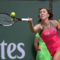 Photo - Jelena Jankovic, of Serbia, hits to Caroline Wozniacki, of Denmark, during their fourth round match at the BNP Paribas Open tennis tournament, Tuesday, March 11, 2014, in Indian Wells, Calif. (AP Photo/Mark J. Terrill)