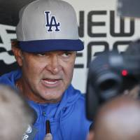 Photo - Los Angeles Dodgers manager Don Mattingly talks about his team during the managers dugout press conference prior  to an MLB Naational League baseball game against the San Diego Padres Wednesday, April 2, 2014, in San Diego.  (AP Photo/Lenny Ignelzi)