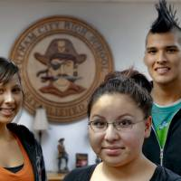 Photo - Indian Education organization members Sydney Keith, Jessica Hulbutta and Celo Keith, from left, at Putnam City High School. Photo by Chris Landsberger, The Oklahoman  CHRIS LANDSBERGER - CHRIS LANDSBERGER