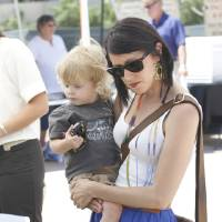 Photo - FILE PHOTO: Coleen Conine and her 21-month-old son Palmer shop for produce at the OSU/OKC Farmers Market in the Whole Foods Market parking lot in Oklahoma City last spring.  Steve Gooch - The Oklahoman
