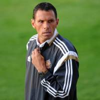 Photo - Sunderland Premier soccer team manager Gus Poyet, of Uruguay, looks out during the pre-season friendly against Spanish team Real Betis at Heritage Park, Sunderland, Thursday Aug. 7, 2014. (AP Photo / Owen Humphreys, PA) UNITED KINGDOM OUT - NO SALES - NO ARCHIVES