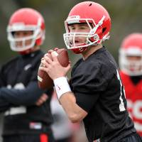 Photo - Georgia quarterback Hutson Mason (14) drops back to pass during a Georgia spring football practice on Tuesday, March 18, 2014, in Athens, Ga. (AP Photo/Athens Banner-Herald, AJ Reynolds)