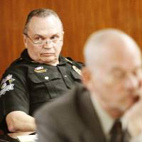Photo - Oklahoma County Sheriff John Whetsel listens to testimony Friday during a civil trial involving an alleged assault at the jail. Photos By Steve Gooch, The Oklahoman
