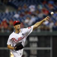 Photo - Philadelphia Phillies' Cole Hamels pitches during the third inning of a baseball game against the Washington Nationals, Tuesday, Aug. 26, 2014, in Philadelphia. (AP Photo/Matt Slocum)