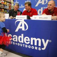 Photo - MAJOR LEAGUE BASEBALL TEAM / CHILD / CHILDREN / KIDS: 23-month-old Taryn Ross of Oklahoma CityTexas looks over the table at Round Rock Express Manager Bobby Jones, Texas Rangers coach Scott Coolbaugh, and Rangers pitcher Matt Harrison during the team's Winter Caravan stop in Oklahoma City, Thursday, Jan. 26, 2012. Photo by Bryan Terry, The Oklahoman