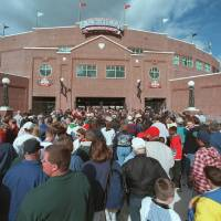 Photo - This 1998 photo shows fans lining up to attend the first baseball game at what is now called Chickasaw Bricktown Ballpark, which was paid for by the original MAPS tax. Photo by Doug Hoke, The Oklahoman Archives