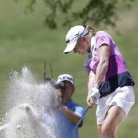 Photo - Stacy Lewis blasts out of the sand on the 11th hole during the final round of the North Texas LPGA Shootout golf tournament at Las Colinas Country Club in Irving, Texas, Sunday, May 4, 2014. (AP Photo/LM Otero)
