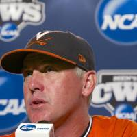 Photo - Virginia coach Brian O'Connor speaks to reporters at a news conference, Sunday, June 22, 2014, in Omaha, Neb. The NCAA baseball College World Series finals between Virginia and Vanderbilt begin on Monday. (AP Photo/Nati Harnik)