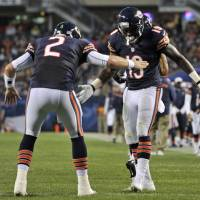 Photo - Chicago Bears wide receiver Joe Anderson (19) celebrates his touchdown reception with quarterback Jordan Palmer (2) during the first half of a preseason NFL football game against the Cleveland Browns, Thursday, Aug. 29, 2013, in Chicago. (AP Photo/Jim Prisching)