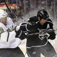 Photo - Dallas Stars' Reilly Smith, left, collides with Los Angeles Kings' Matt Greene during the first period of an NHL hockey game in Los Angeles, Sunday, April 21, 2013. (AP Photo/Jae C. Hong)