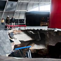 Photo - Officials view a sinkhole that opened up in the Skydome showroom, Wednesday  at the National Corvette Museum in Bowling Green, Ky.    AP Photo  Miranda Pederson - AP
