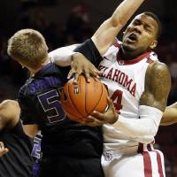 Photo - Oklahoma's Romero Osby (24) collides with Kansas State's Will Spradling (55) during an NCAA men's basketball game between the University of Oklahoma (OU) and Kansas State at the Lloyd Noble Center in Norman, Okla., Saturday, Feb. 2, 2013. Photo by Nate Billings, The Oklahoman
