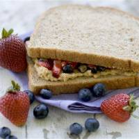 Photo - In this image taken on July 9, 2012, a healthy remake of a PB&J sandwich with fresh berries is shown in Concord, N.H. (AP Photo/Matthew Mead)