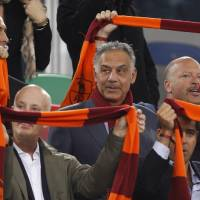 Photo - FILE - In this April 8, 2013 file photo, AS Roma soccer club president James Pallotta, center, follows a Serie A soccer match between AS Roma and Lazio at Rome's Olympic stadium. For Italian football fans, merely mentioning the word