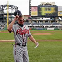 Photo -   Altanta Braves Chipper Jones walks to the dugout after presenting the lineup card before a baseball game against the Pittsburgh Pirates at PNC Park in Pittsburgh Wednesday, Oct. 3, 2012. (AP Photo/Gene J. Puskar)